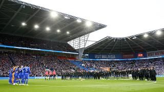 Cardiff City and Leicester City observe a minute's silence.
