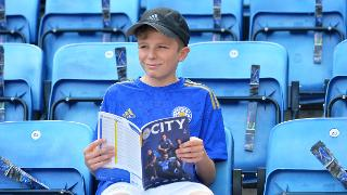 Leicester City Fan With Programme